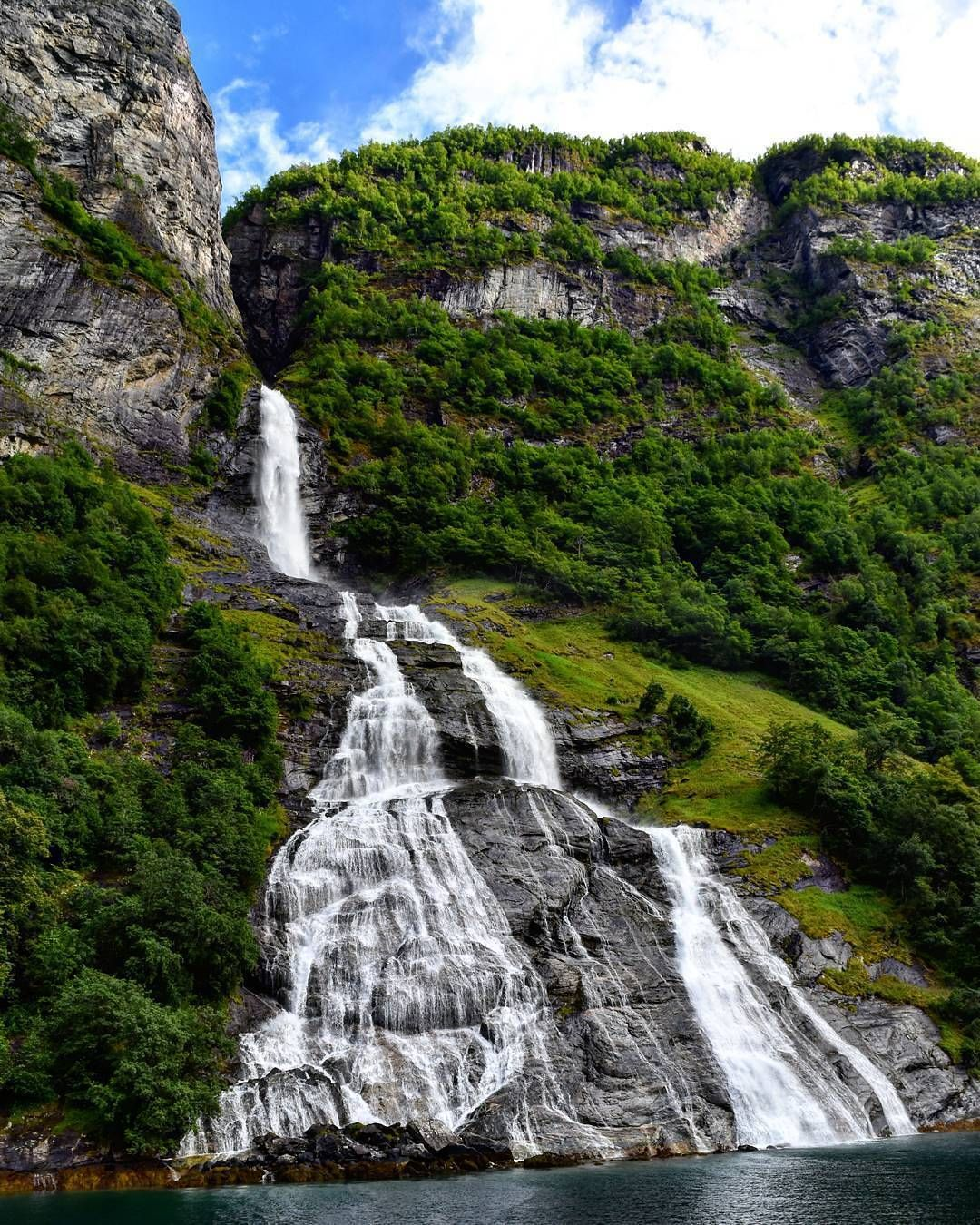 Friaren Waterfall, Norway. Friaren is a 440 meters high lone waterfall sitting across from the famed Seven Sisters on the Geiranger Fjord. Friaren is situated about 2,5 km west of Geiranger. For visiting the waterfall is is possible to take the ferry or rent a boat in Geiranger.
