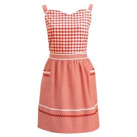 "Red and white gingham apron with sweetheart bodice and gathered waist. 100% Cotton.   Product: ApronConstruction Material: CottonColor: Red and whiteFeatures: Checkered patternDimensions: 30"" H x 32"" W Cleaning and Care: Machine washable"
