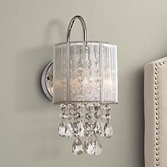 Dazzling modern decor at its finest this beautiful wall sconce features a distinctive shade and & Possini Euro Silver Line 12