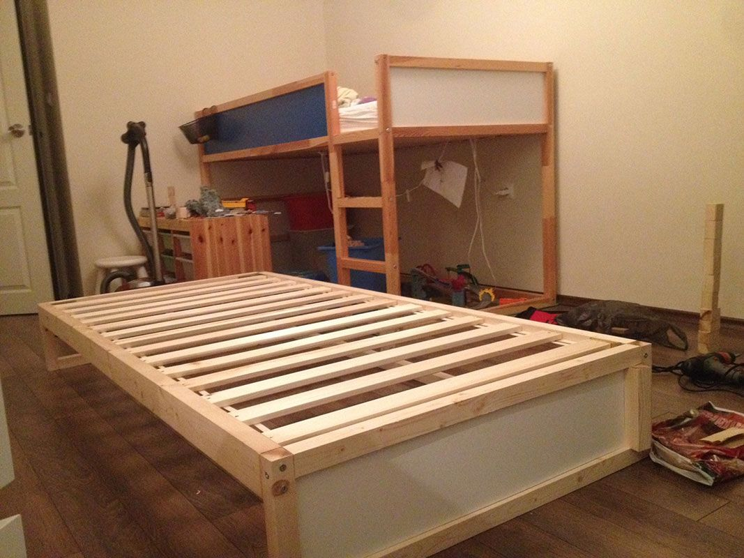 i hacked an extra bunk under the ikea kura double bunk bed you can hide