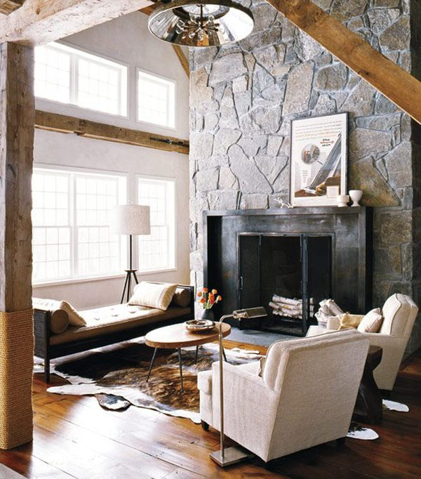 Dark fireplace complements lovely light colored decor Stone