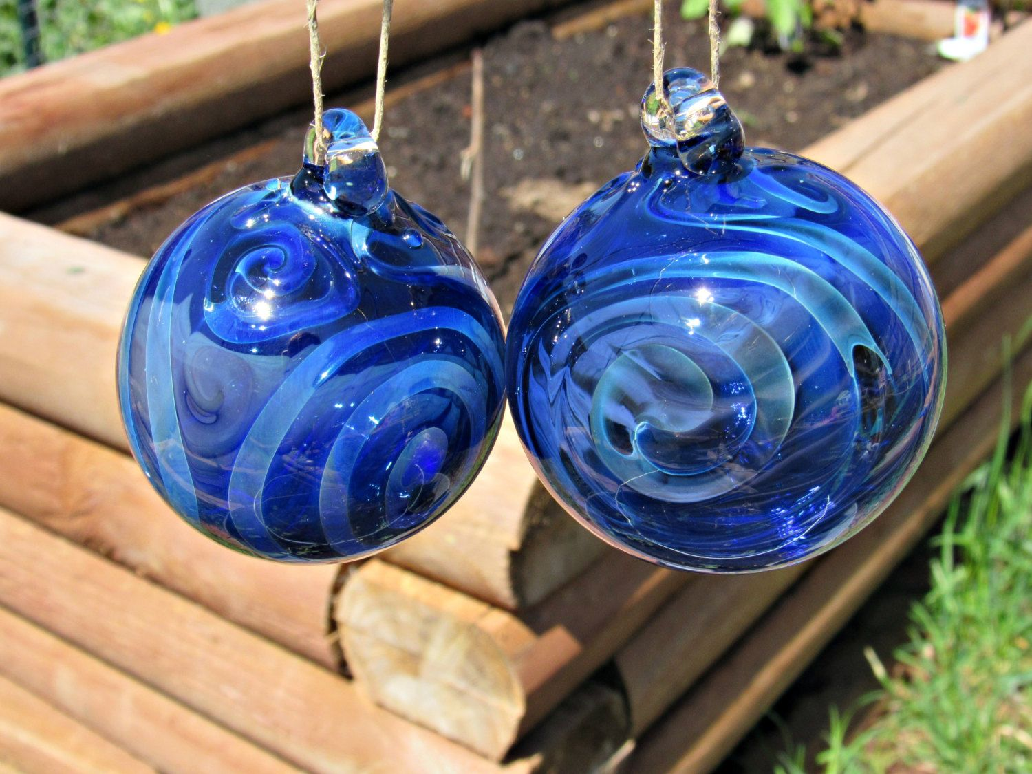 A personal favorite from my Etsy shop https://www.etsy.com/listing/291189289/handmade-glass-ornamentsuncatcher-blue