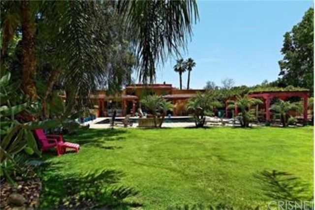 This one-of-a-kind compound boasts a Main House with 5BR & 6BA, a Guest House with 1BR + LR & 1BA, and an Apt and Caretakers unit.