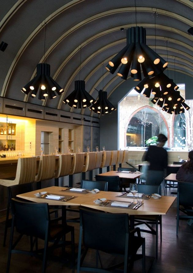 Restaurants Curves ceiling with interesting lighting fixtures