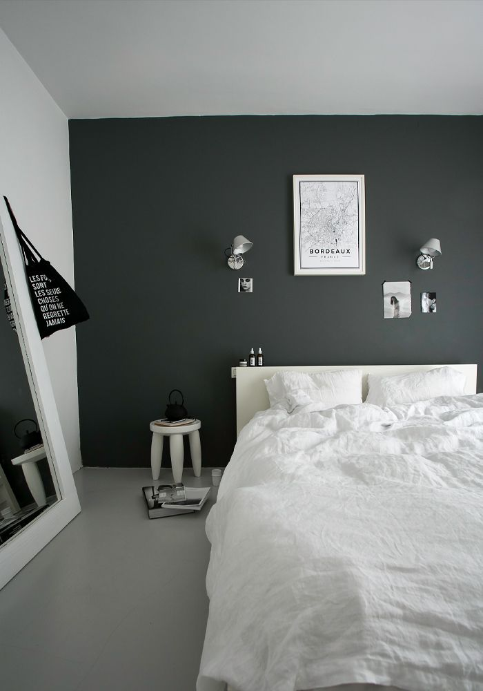 How to decorate a bedroom with a dark grey feature wall