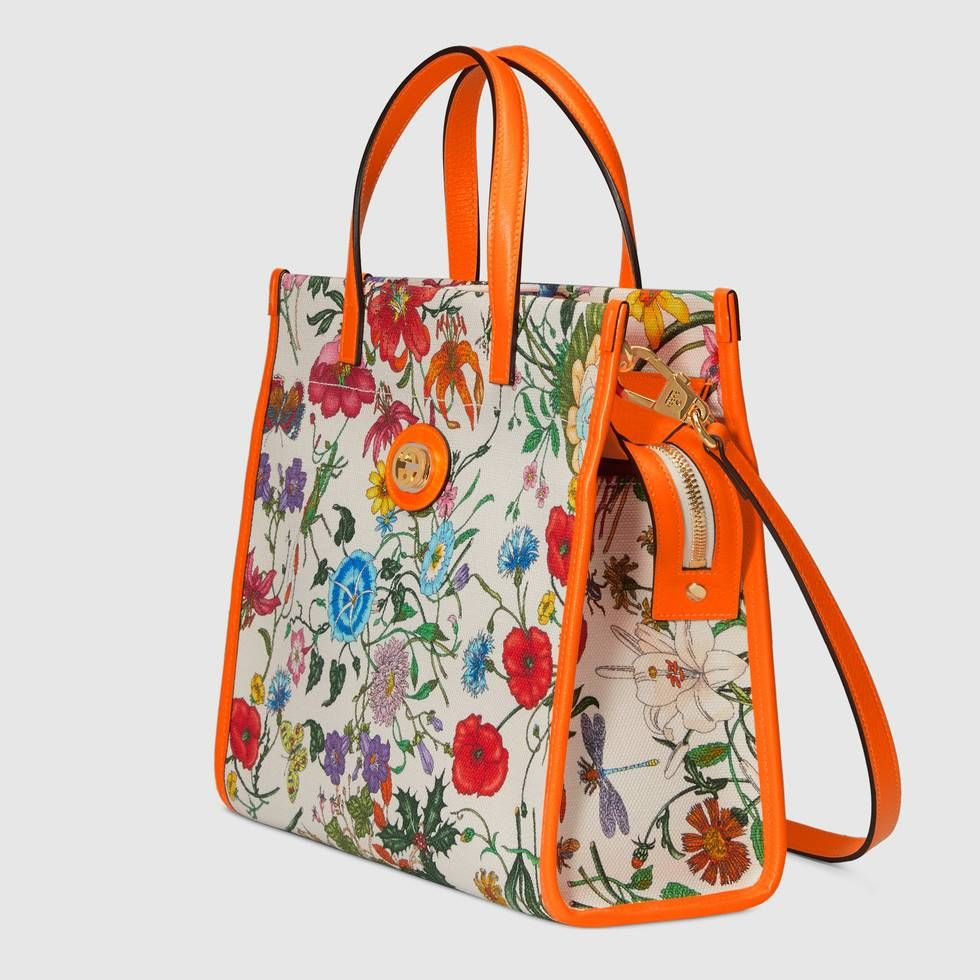 8934ff5d3cc Shop the Medium Flora tote bag by Gucci. Presented on a tote bag in canvas