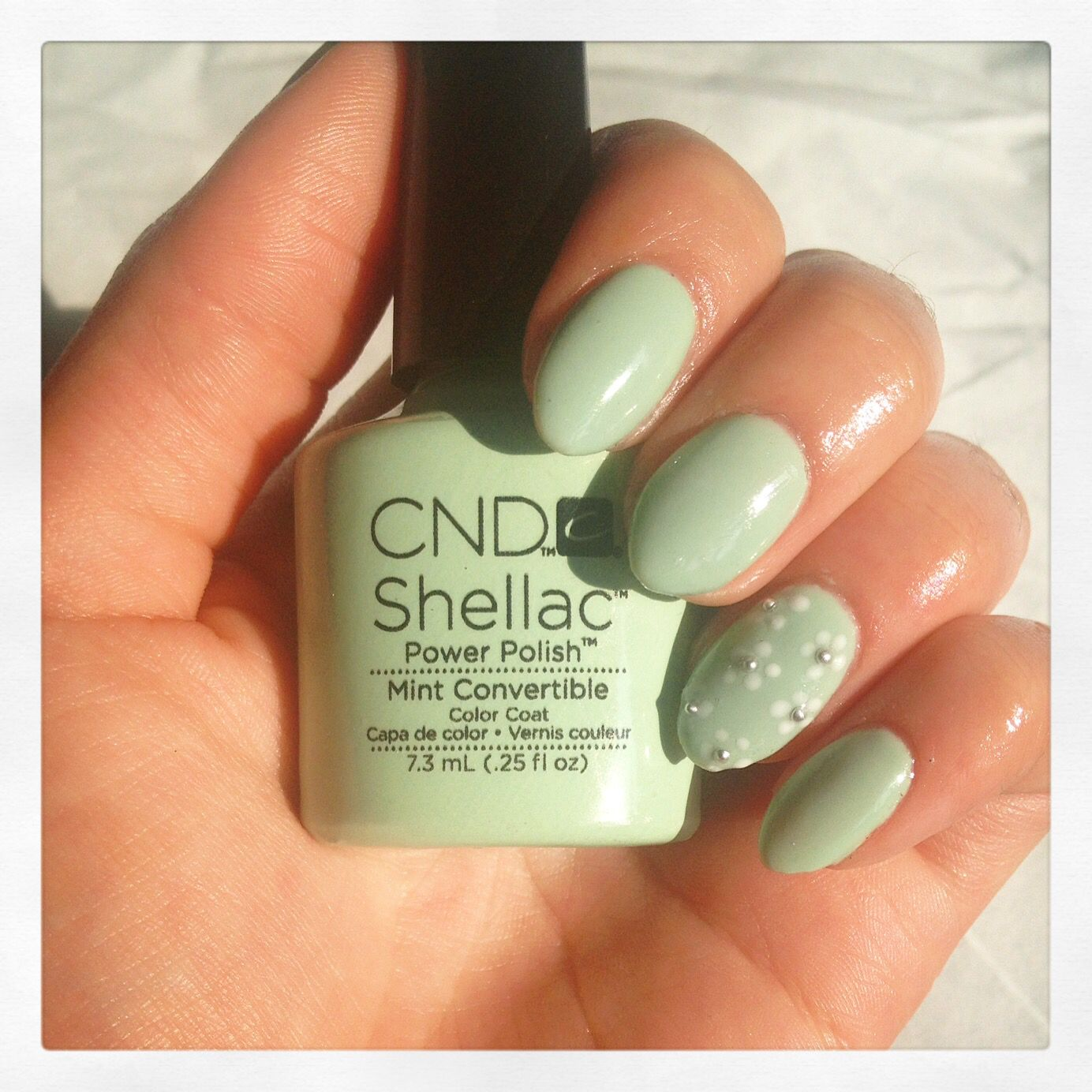 Almond nails in mint convertible by shellac with floral nail art ...