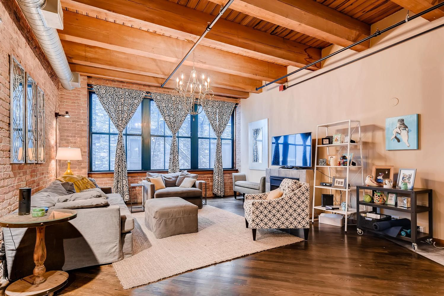 Enjoyable Modern Loft Living Room With Hardwood Floors Exposed Brick Squirreltailoven Fun Painted Chair Ideas Images Squirreltailovenorg