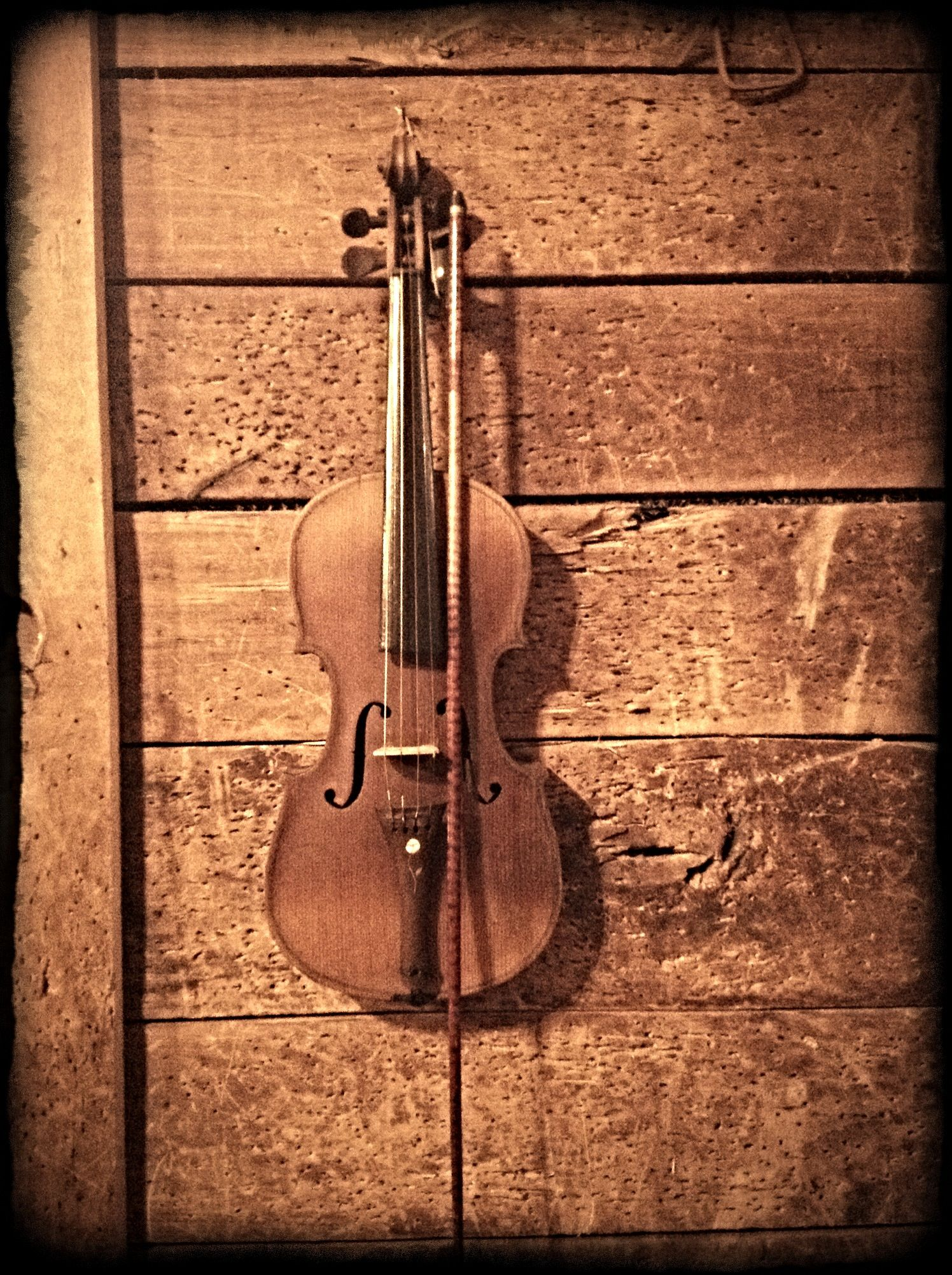 What's found on Colonel's walls reflect his admiration for vintage and musical - like this fiddle. #Fiddle