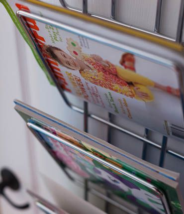 Don't overlook any opportunity to store things! Check out this magazine rack mounted on the inside of a closet door. Also great for holding sketchpads and coloring books.