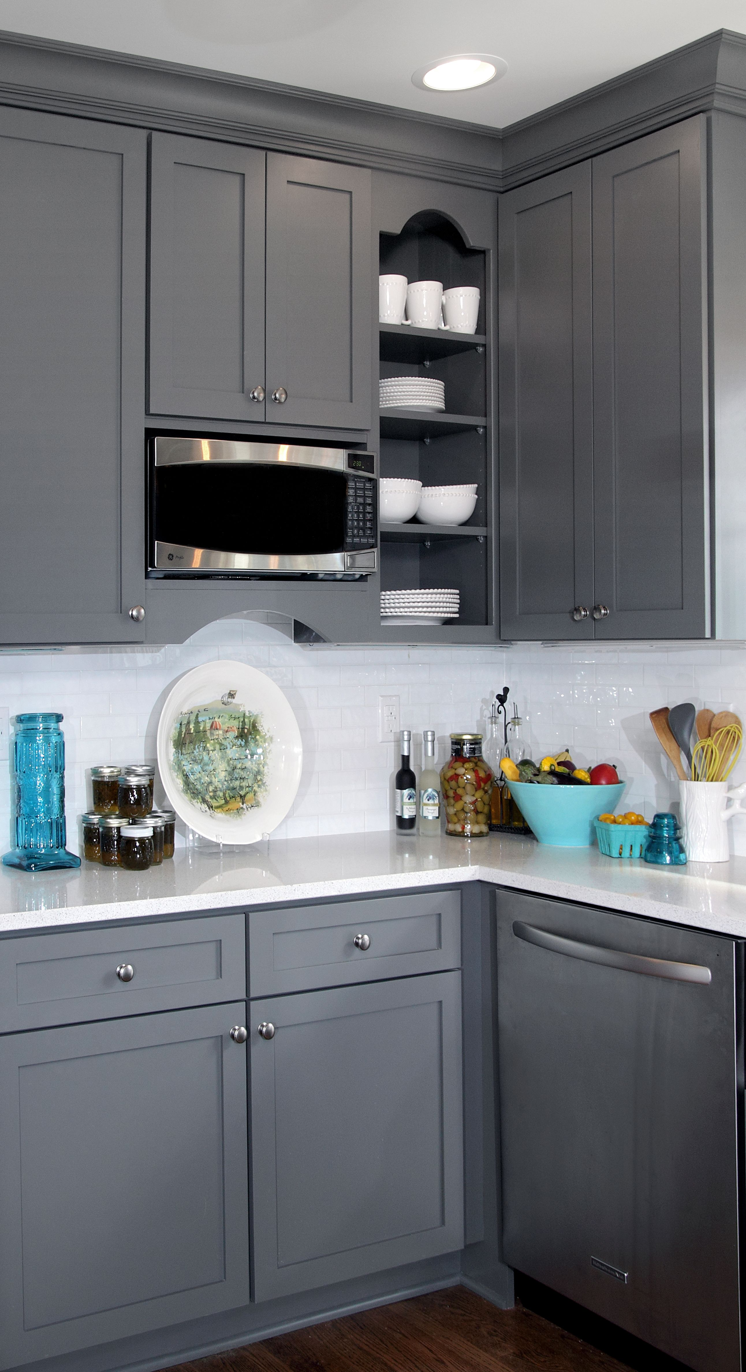 Gray and white transitional kitchen design with teal blue and yellow
