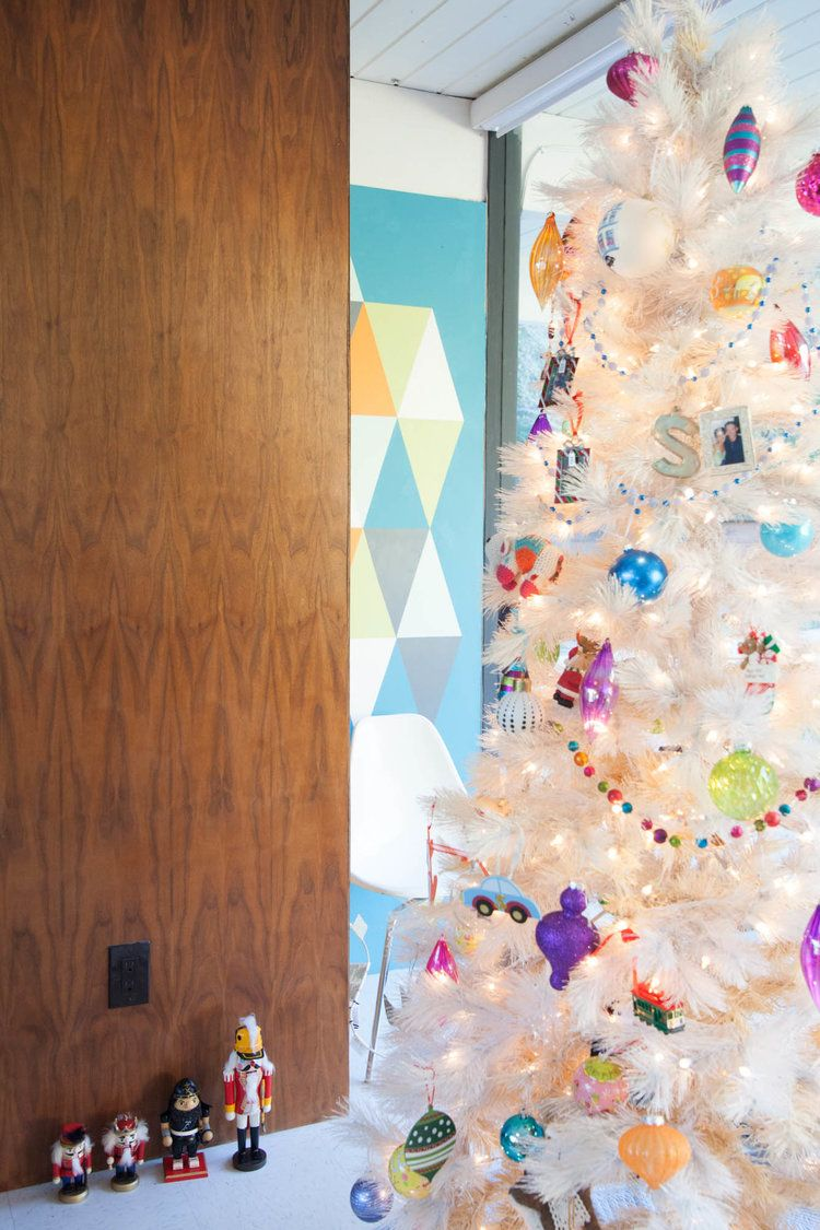 Our Mid Century Modern White Christmas Tree And The Kids Growing Nutcracker Collection Mid Century Modern Christmas Modern Christmas Tree Modern Christmas