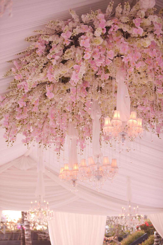 12 Dazzling Ways To Decorate Reception Ceilings Wedding Ceiling Floral Arrangements Wedding Reception Ceiling