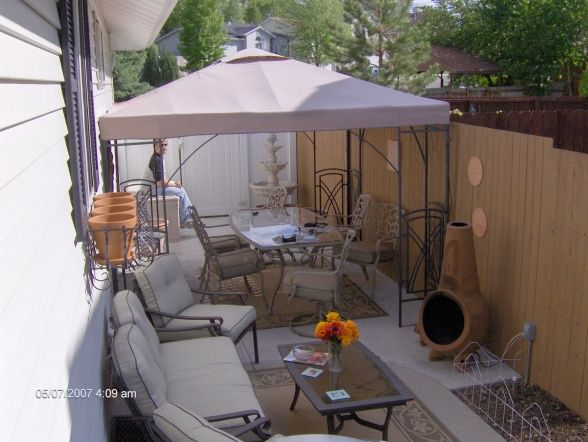Outdoor patio ideas for small spaces small spaces long for Small backyard patio ideas