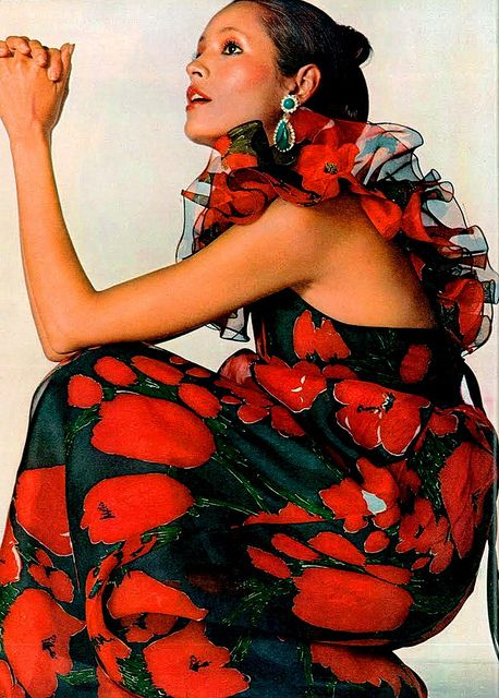 Rare and Ruffled. Model Barbara Carrera in a brilliant poppy print organza halter dress with cascading ruffles at the back. Photo by Irving Penn for US Vogue, November 1971.