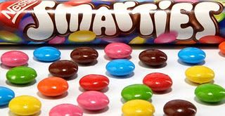 I loved Smarties! I used to collect the lids that had a letter of the alphabet on them. They didn't have blue Smarties in those days.