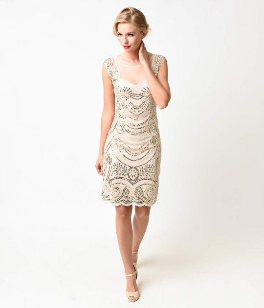 One second while we pop our eyes back in, dames. This glamorous yet subtle flapper frock balances deco decadence with contemporary class, intricately beaded throughout every inch in dizzying swirls of white and silver beads offset with gleaming gold sequi