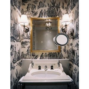 Photo of Dramatic bathroom with classic fixtures and mixed metals