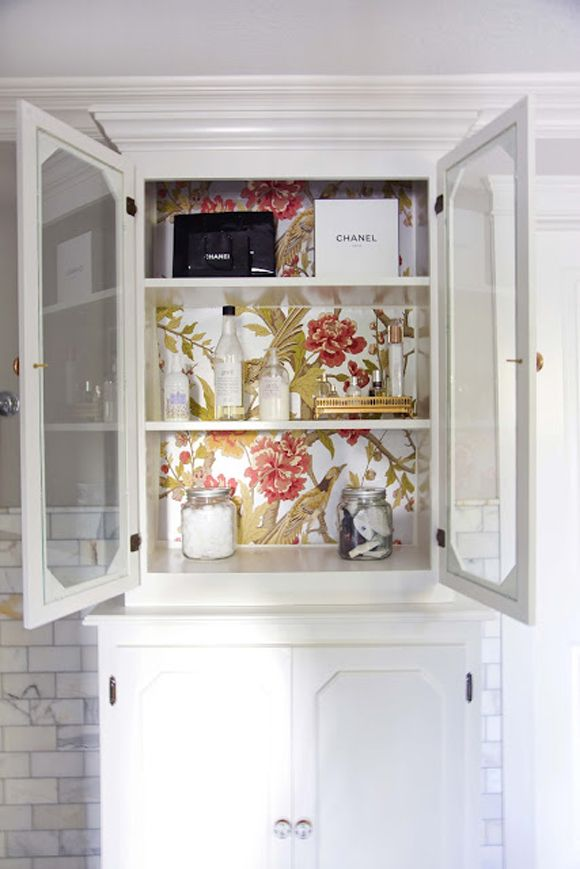 wallpaper on inside of cabinets - have my eye on the bathroom and china cabinets