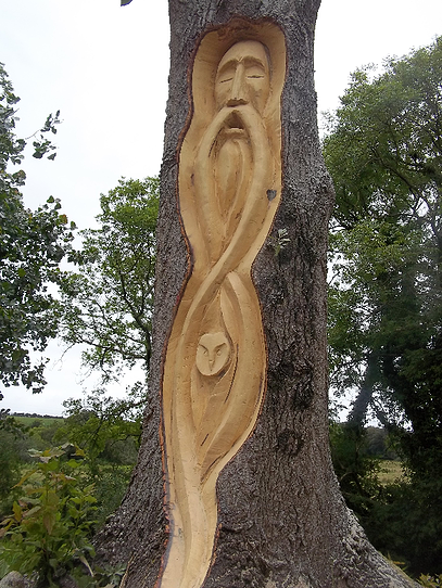 Wood Spirit With Owl Carved With A Chainsaw Into Living