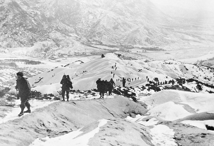 American GIs thread their way over snow-covered hills North of Seoul, South Korean capital on January 14, 1951, during earlier stages of U.N. withdrawal. #