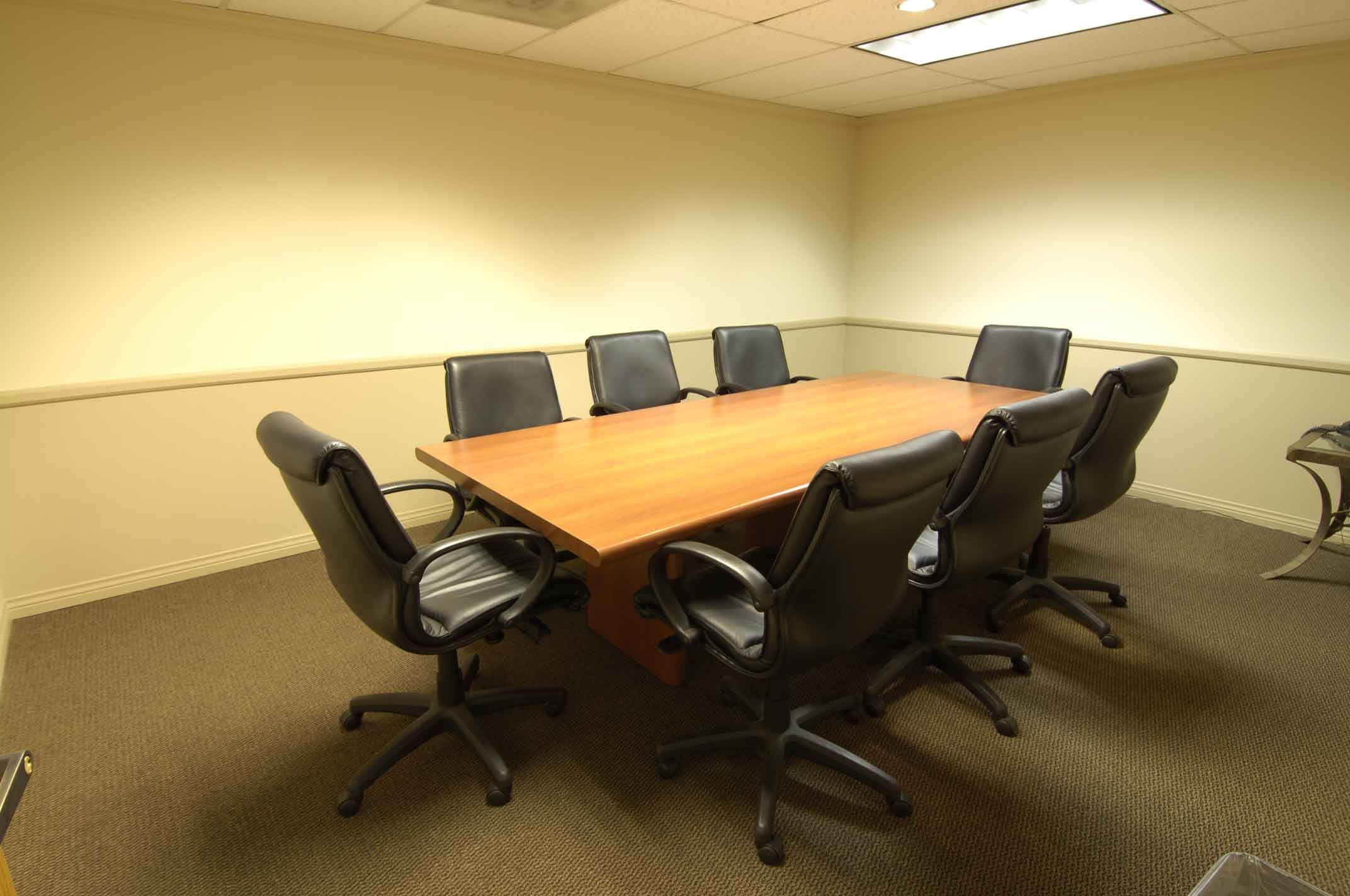 Simple Office Meeting Room Decor With Wooden Meeting Table And Cozy Black Swivel Chair Also Nice Gray Carpet Excellent Office Meeting Room Design For Modern Off