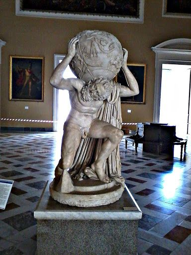 The Farnese Atlas. A 2nd-century Roman marble copy of a Hellenistic sculpture of Atlas kneeling with a globe weighing heavily on his shoulders. This is the oldest extant statue of the Titan of Greek mythology, and the oldest representation of the celestial sphere. Standing 2.1 meters tall, and the globe is 65 cm in diameter.