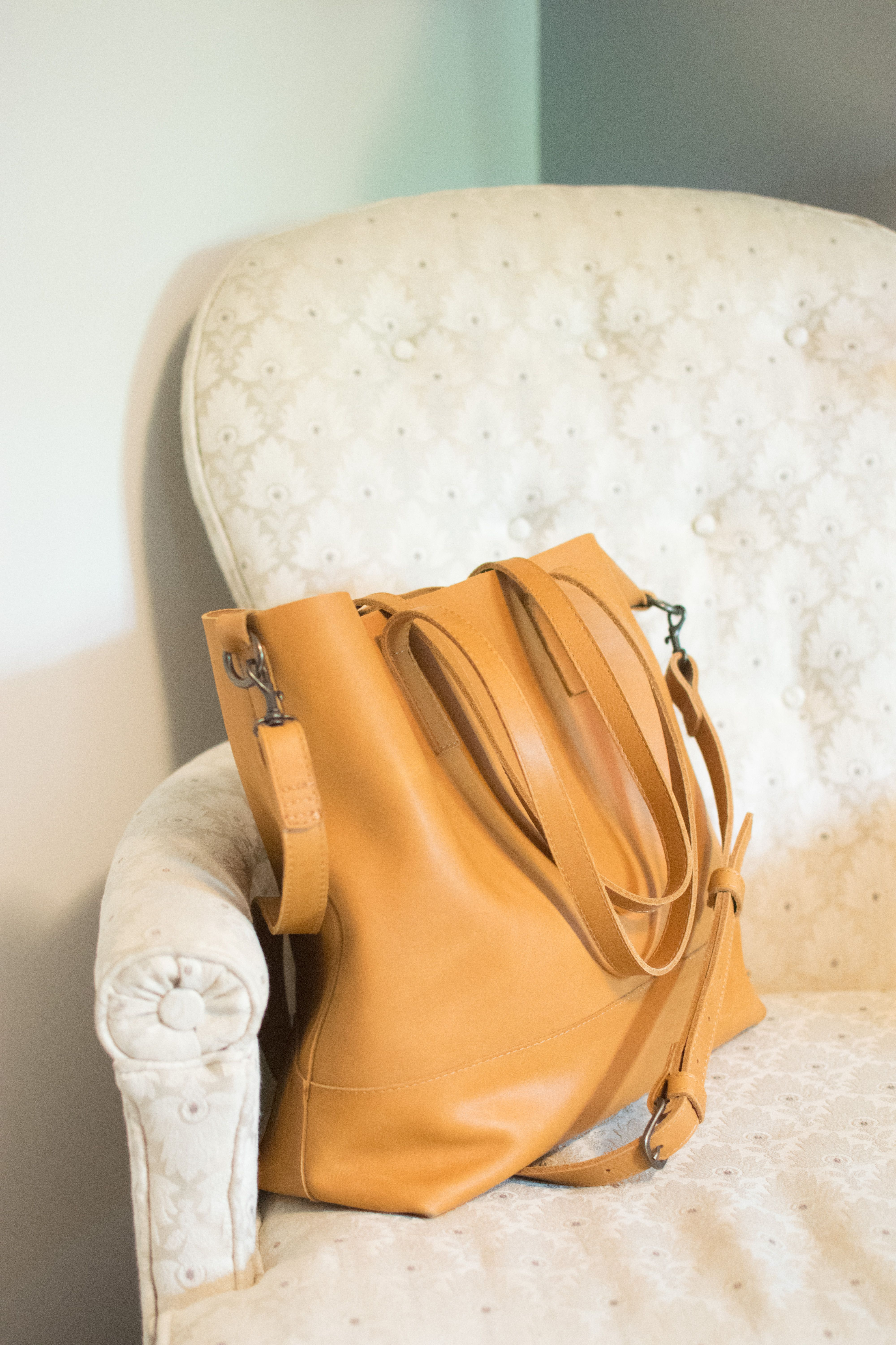94612aa084d7 Abera Crossbody Tote in Cognac by FashionABLE is the perfect leather fair  trade bag for any occasion. The multi-function tote showcases the  purchaser's ...