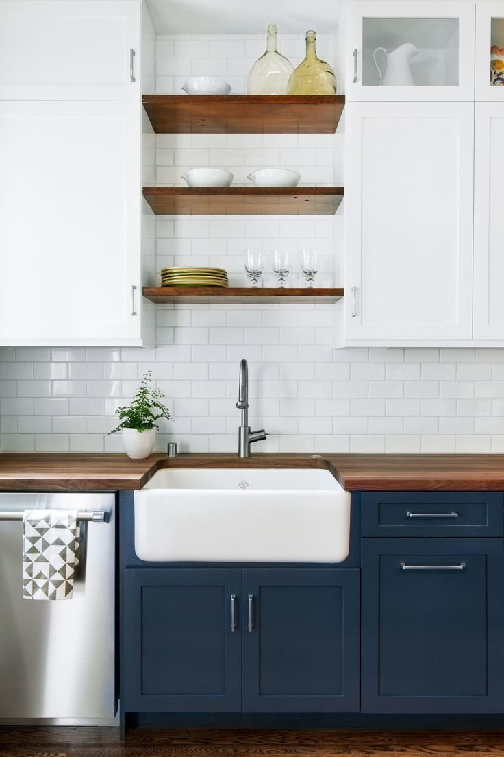 Dark Base Cabinets, White Top Cabinets. Open Wood Shelves And Big Cream  Sink.