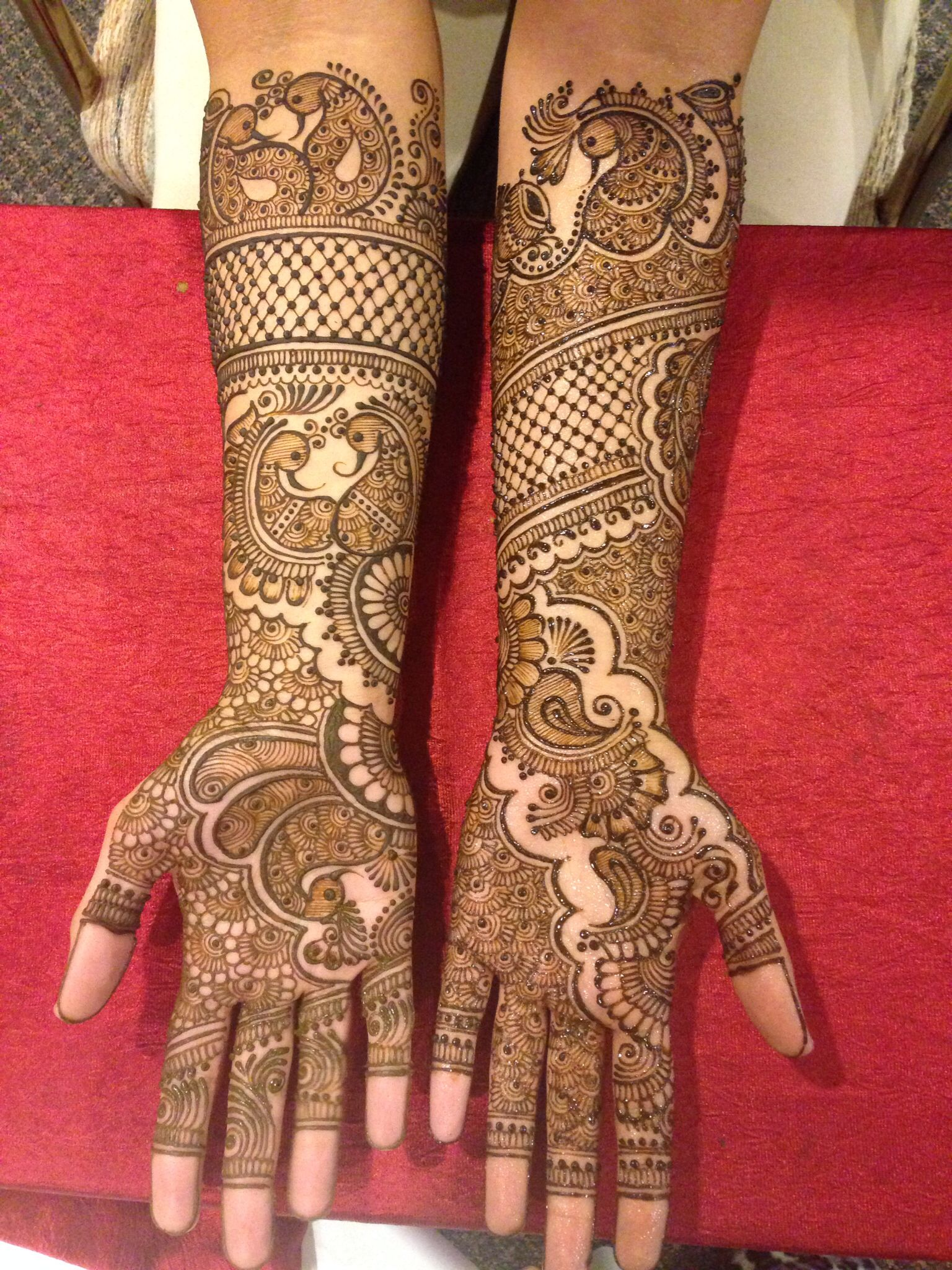 Professional expert bridal henna on hands and feet at Married to design