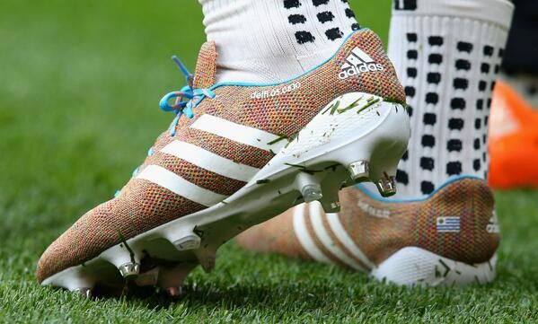 wholesale dealer 5b4e9 e8331 Embedded image permalink The knitted boots of Luis Suarez (pic courtesy of  Feint Zebra, Twitter)