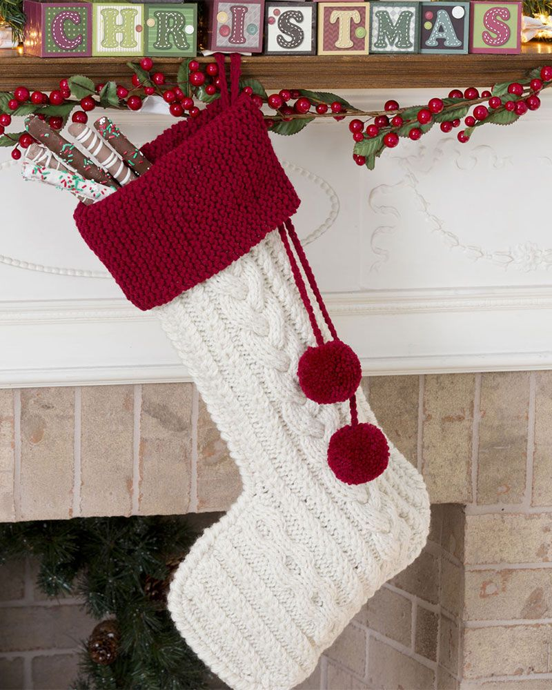 Elegant Aran stitches create this classic knitted Christmas stocking ...