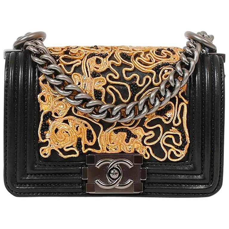60851b96c5d4 For Sale on 1stdibs - SUPERB CHANEL mini BOY bag in black leather. It is
