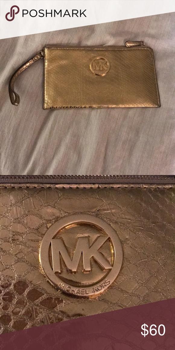 2eb3228ba994 Michael Kors Gold Clutch. Used twice! Adorable gold flat clutch michael kors!  No stains or flaws. Michael Kors Bags Clutches & Wristlets