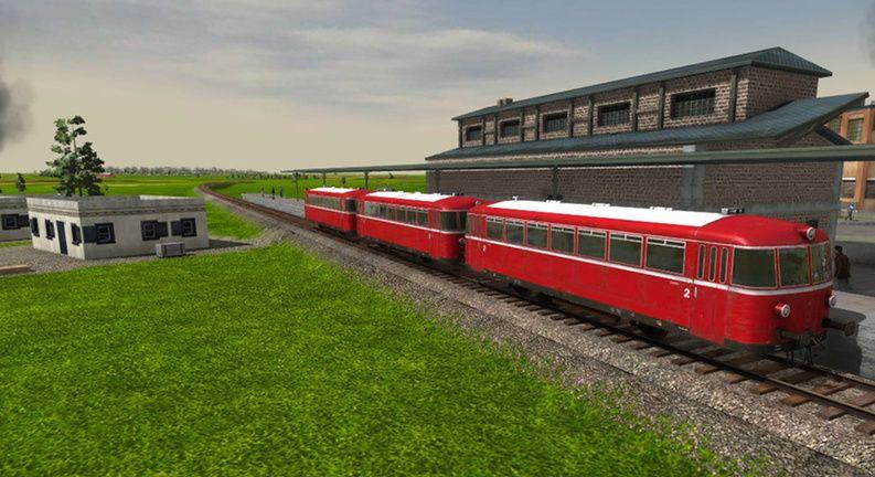 Het triootje railbussen op een station.