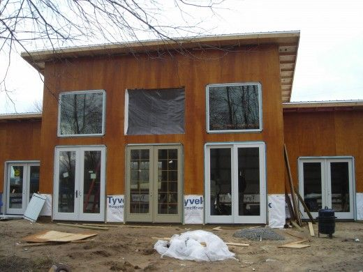 How to build an affordable modern home pole barn house for Affordable pole barns