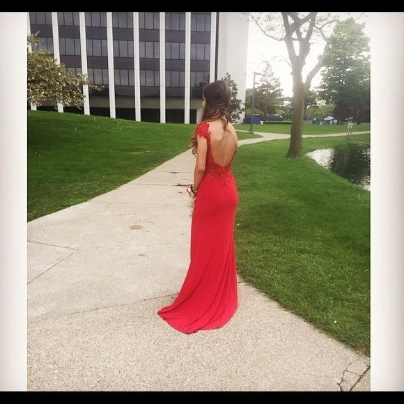 Elegant red prom dress Read description  Size 0 takin in at the waist a tad. Beautiful red cap sleeve with red lace and shear detail. Backless with an above knee slit. Message for further details or negotiating MacDuggal Dresses Backless