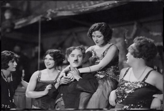 """90th Anniversary - """"The Gold Rush"""" June 26th 1925These are behind the scenes - Charlie and the dance hall girls in the dance hall, in the tramp's cabin, Charlie on location in Northern California putting on make-up & instructions in dance on the set..."""