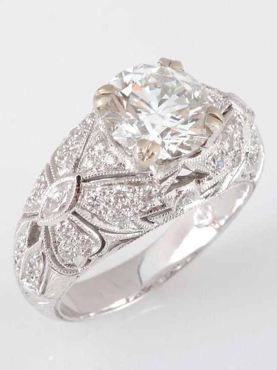 Estate 18 karat white gold ring with a center round brilliant diamond at 2.02 carats SI clarity H color and surrounded by round diamonds at 0.63 carat total weight. The center diamond is EGL (European Gemological Laboratory) certified,  #US80128903D.