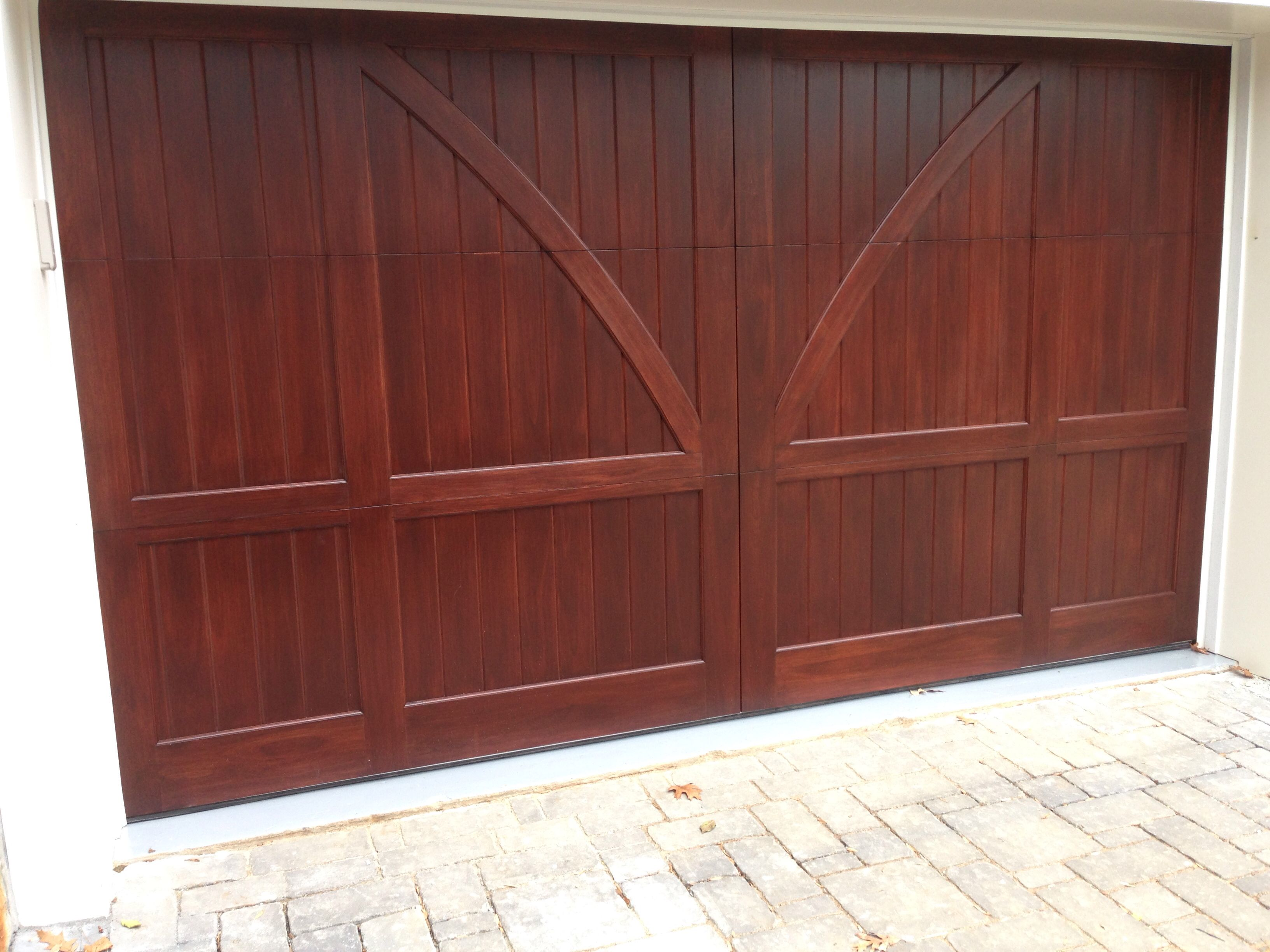 Custom stained clear red grandis carriage house wood for Stained garage doors