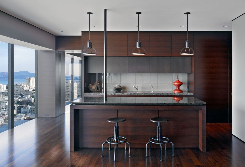High rise apartment and its stylish wooden inspired minimalist kitchen design