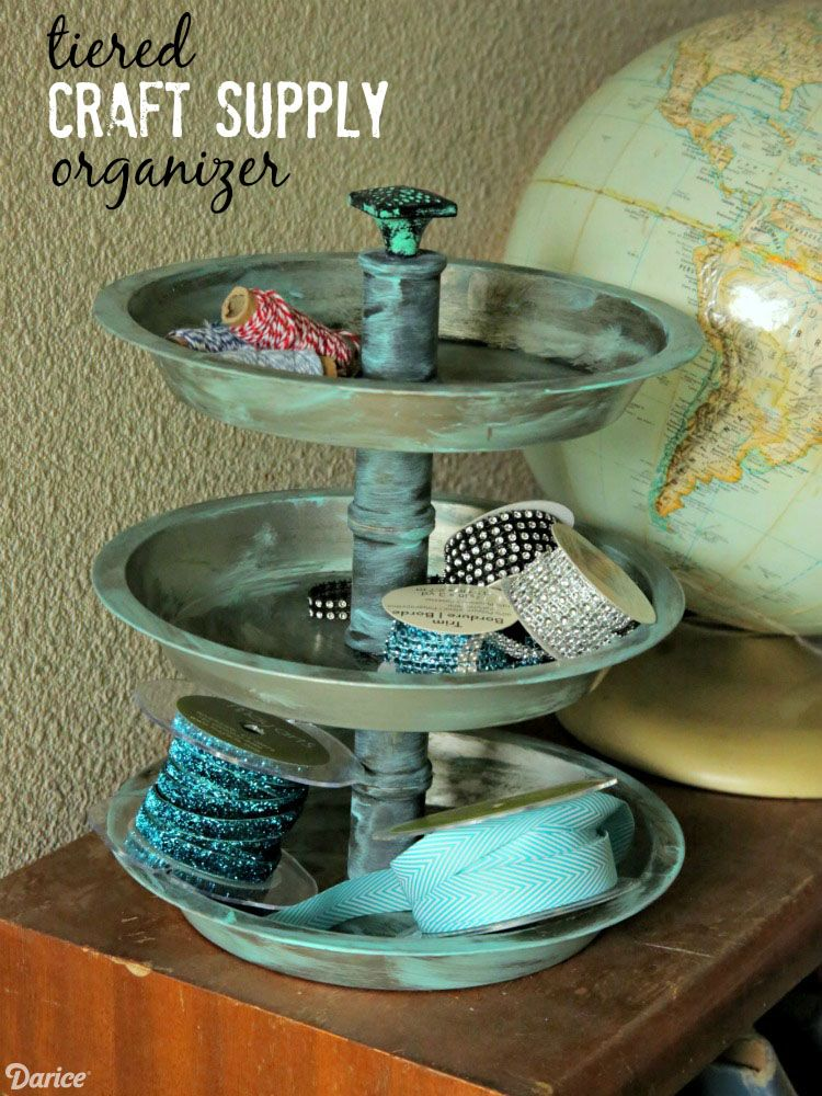 Display your craft supplies in this tiered tray craft DIY organizer using some simple supplies and some inexpensive pie pans from the dollar store.