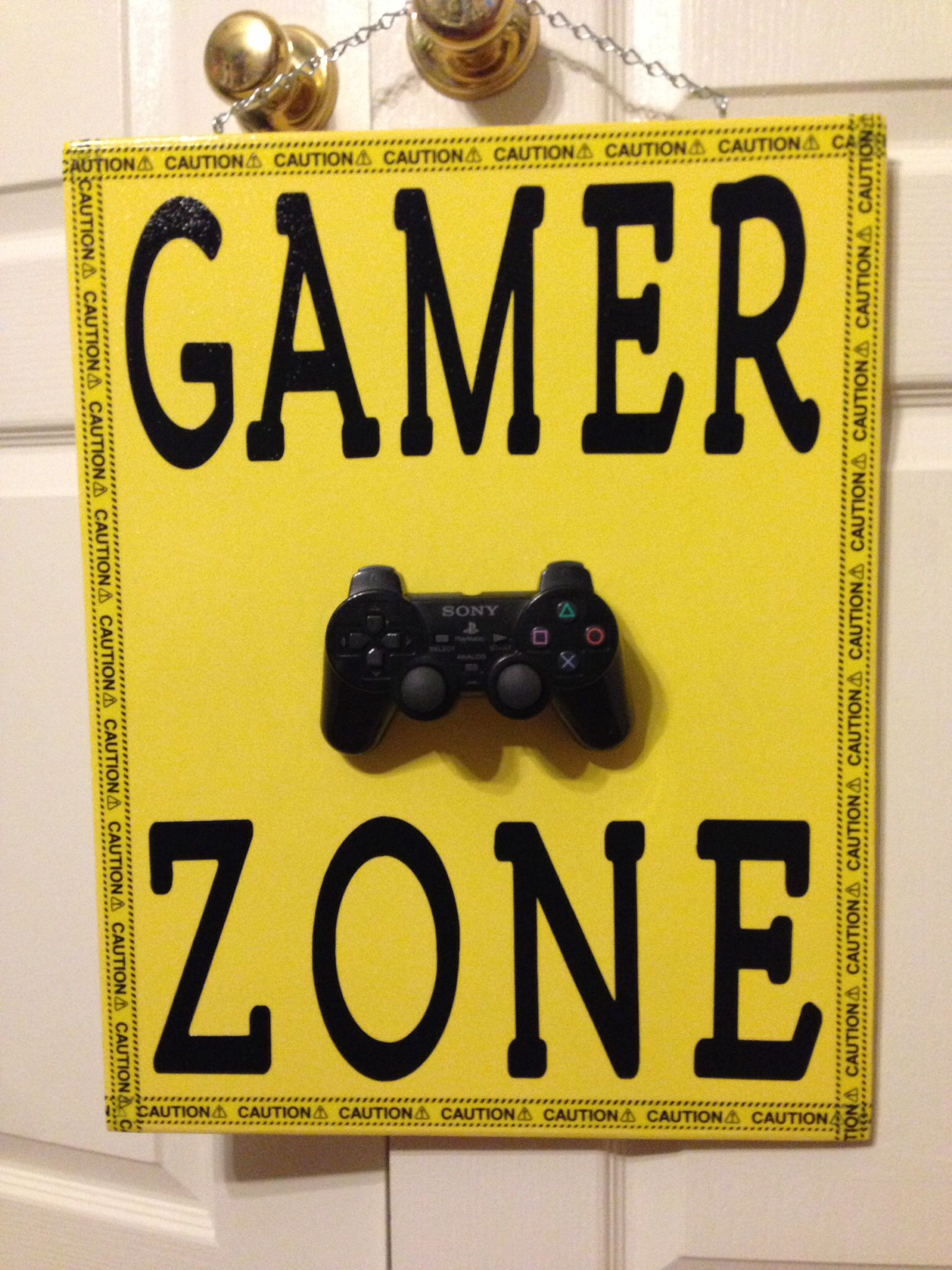 Gamer, Playstation sign made with old controller, caution