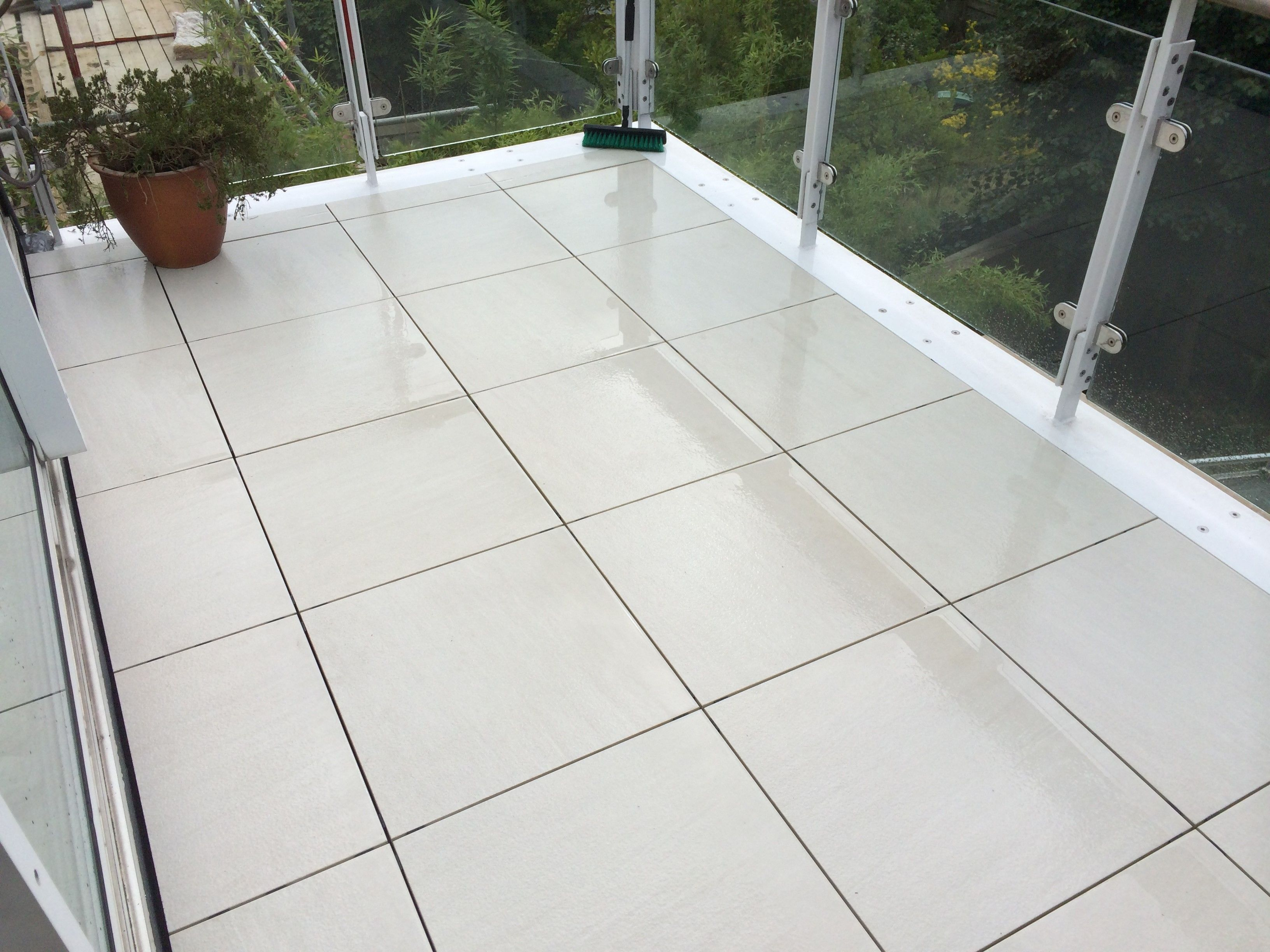 Sandy White installed using self-levelling pedestals in North London # porcelain #paving #luxurymaterials www.exteriorc… | Patio slabs, Outdoor  tiles, Outdoor paving