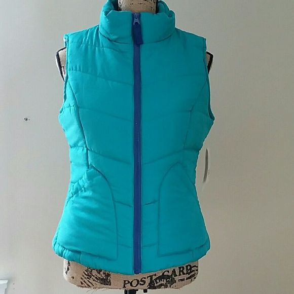 Everlast puffer vest The color is more of a teal than what appears in the pics. This will be be cozy  in the winter!  Layer with your favorite sweater. 100 % polyester, filled with 100 % polyester.  The lining is super soft to the touch.  It feels very plush!  2 slash pockets and a fitted look. Everlast Jackets & Coats Vests