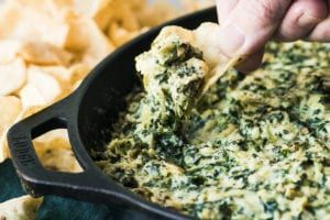 Smokey Spinach Artichoke Dip ~ my cheesy classic hot dip recipe takes a fan favorite appetizer and gives it a twist with smoked mozzarella and gouda cheese. #recipe #easy #hot #baked #best #dip #crockpot #slowcooker #crockpotspinachandartichokedip Smokey Spinach Artichoke Dip ~ my cheesy classic hot dip recipe takes a fan favorite appetizer and gives it a twist with smoked mozzarella and gouda cheese. #recipe #easy #hot #baked #best #dip #crockpot #slowcooker #crockpotspinachandartichokedip