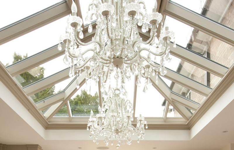A Chandelier Suspended In The Centre Of The Roof Lantern Provides A Stunning Focal Point To Any Room Roof Lantern Orangery Glass Roof