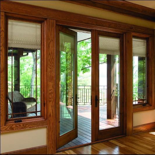 Pella French Doors With Motorized Between The Glass Blinds And Shades That Raise And Lower With The T Hinged Patio Doors French Doors Patio Kitchen Patio Doors