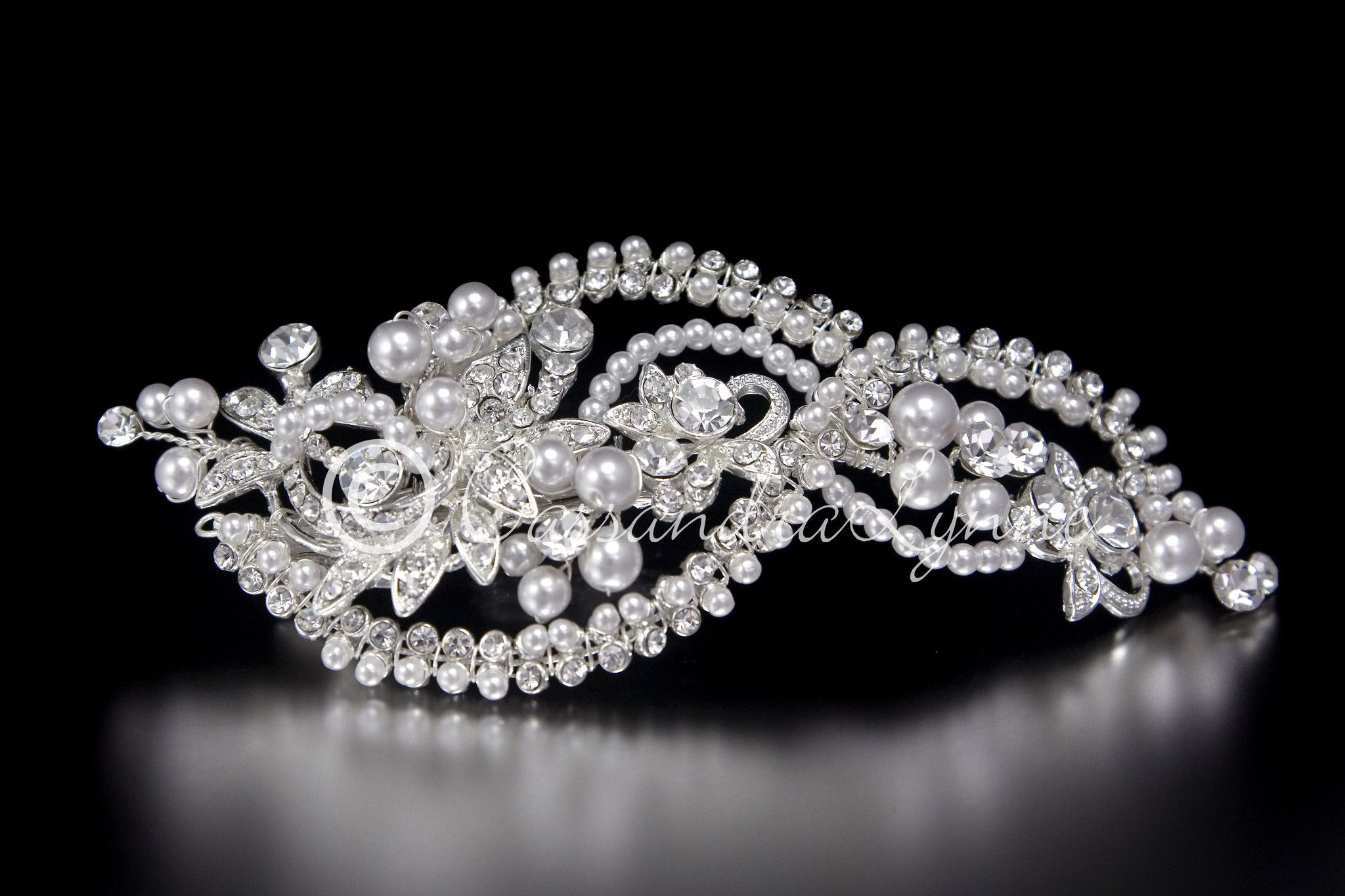 This unique pearl bridal hair clip has pearls and rhinestones woven around  and through a jeweled floral design. You won t be disappointed in the  details of ... 4e6d564cd743