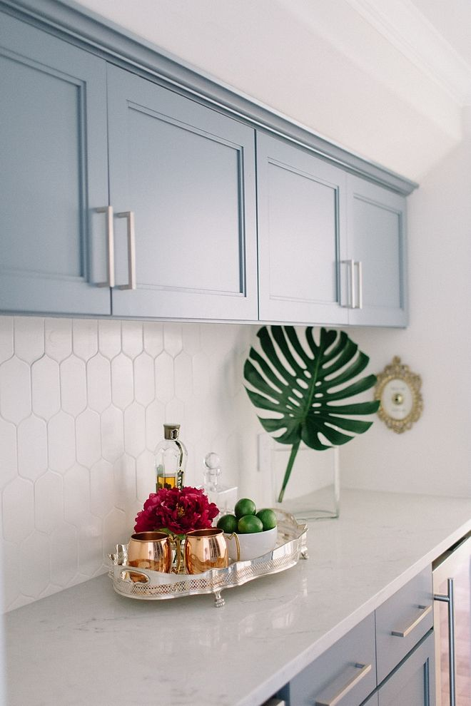 Butler's pantry with blue grey cabinets, Sherwin Williams Storm Cloud, marble-looking countertop and elongated hexagon tile backsplash #SherwinWilliamsStormCloud #blugrey #cabinet #butlerspantry #bluegreykitchens